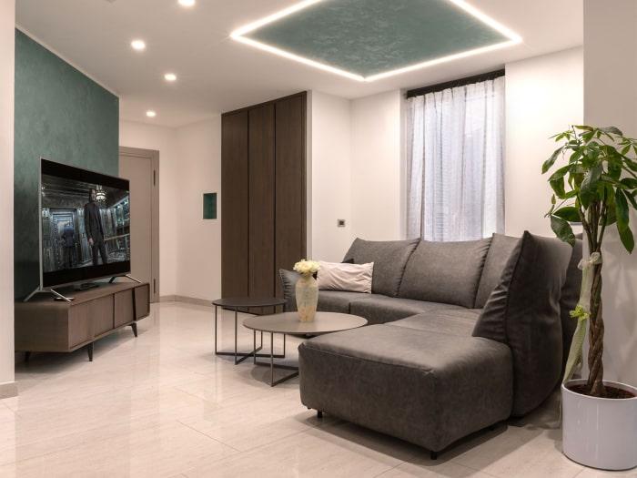 Progetto terminato: soggiorno completo di parete TV e zona relax