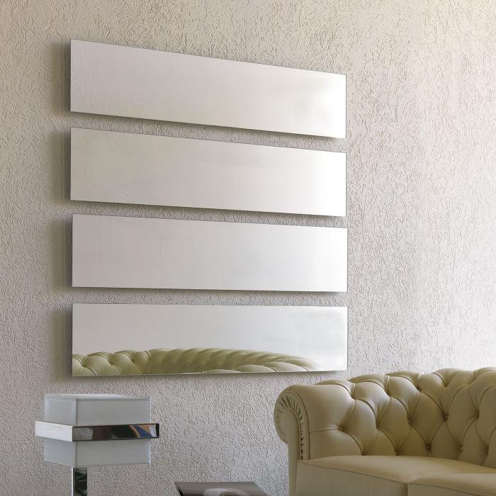 Composizione di specchi rettangolari a parete
