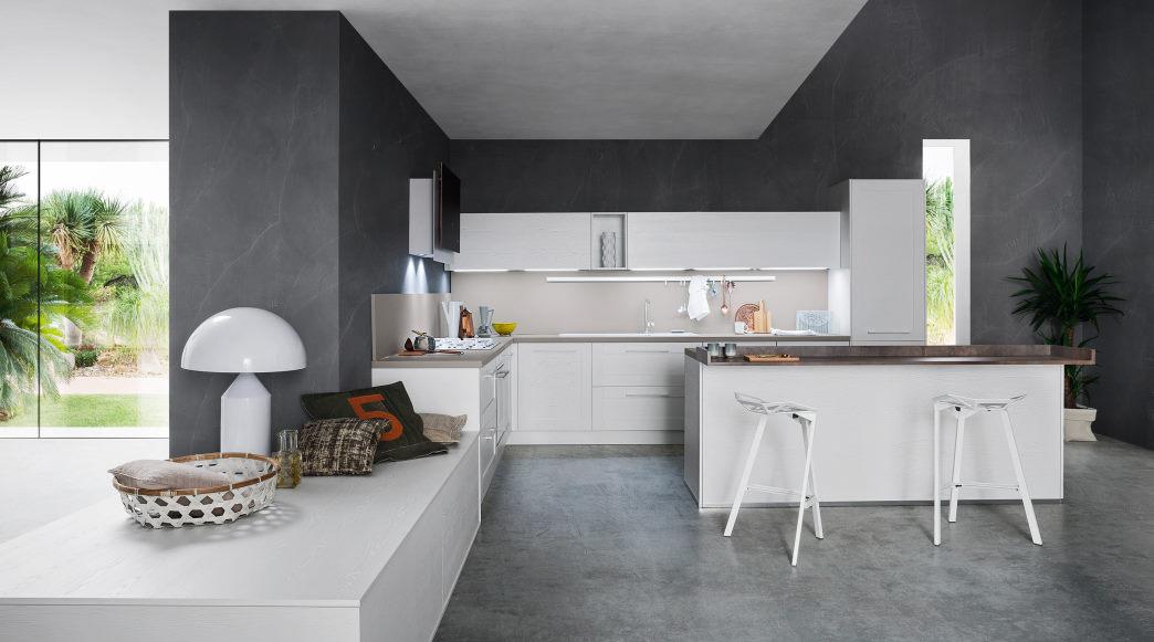 Cucina bianca opaca angolare con piccola isola centrale e piano snack Fourty 03