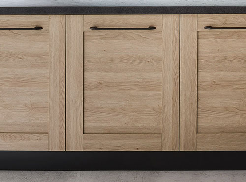 Wooden kitchen doors with black handles and plinth