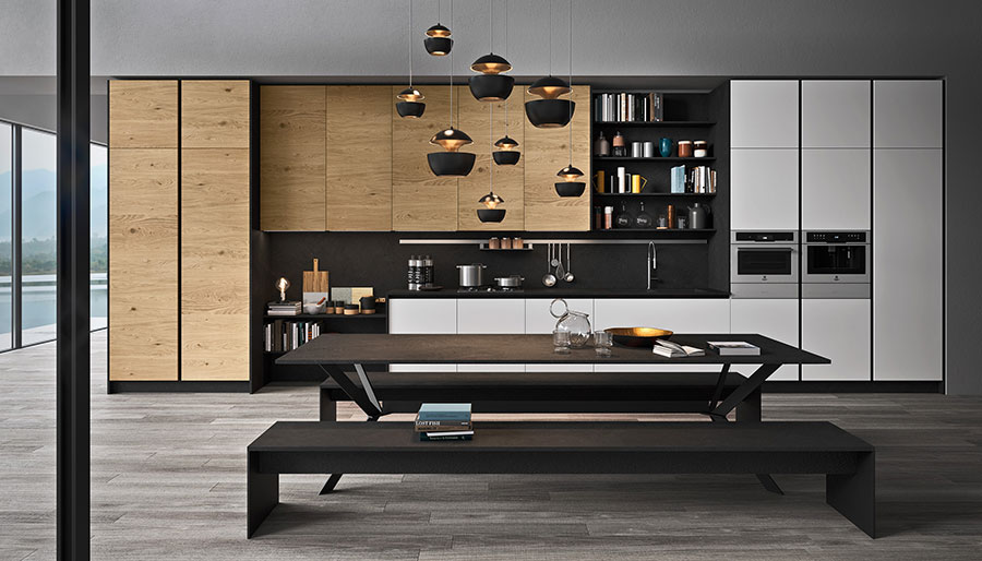Black white and wooden kitchen with no handles