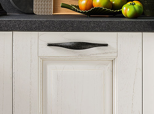 Kitchen door in white decapé wood with black handle
