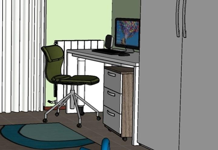 Dettaglio della zona studio con scrivania e sedia ergonomica