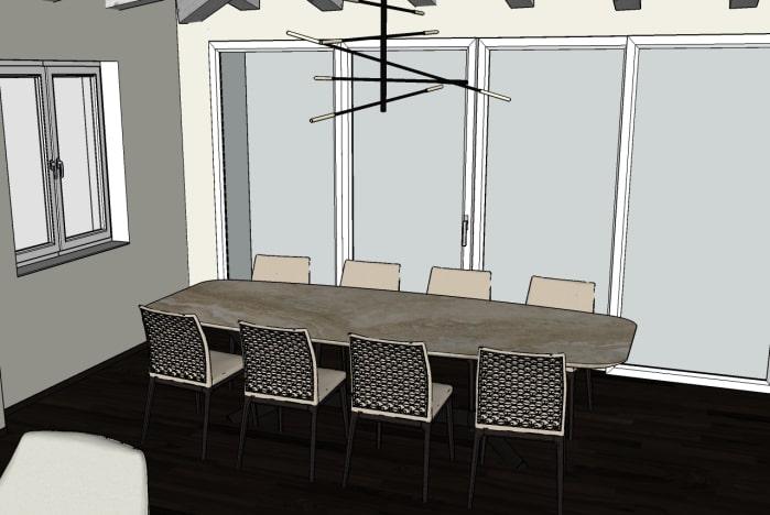 Progetto: dettaglio del tavolo posizionato davanti alle vetrate