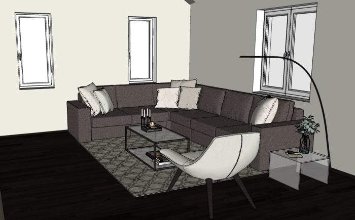 Progetto: vista dell'angolo relax con divano angolare, poltrona e tavolini