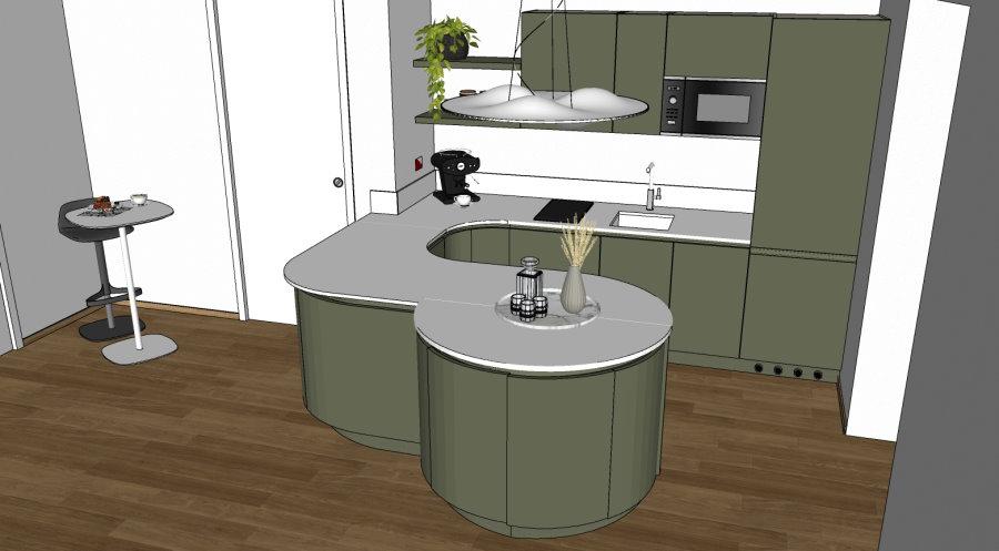 Il piano del cucina è in Corian, è un top unico, senza giunture visibili