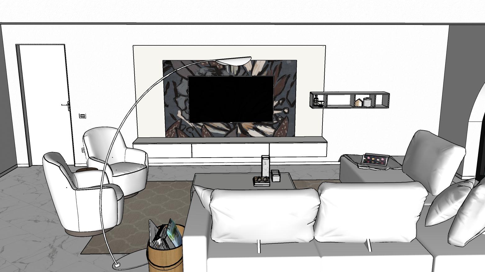 Zona relax con divano, poltroncine, lampada, tavolino e parete attrezzata sospesa