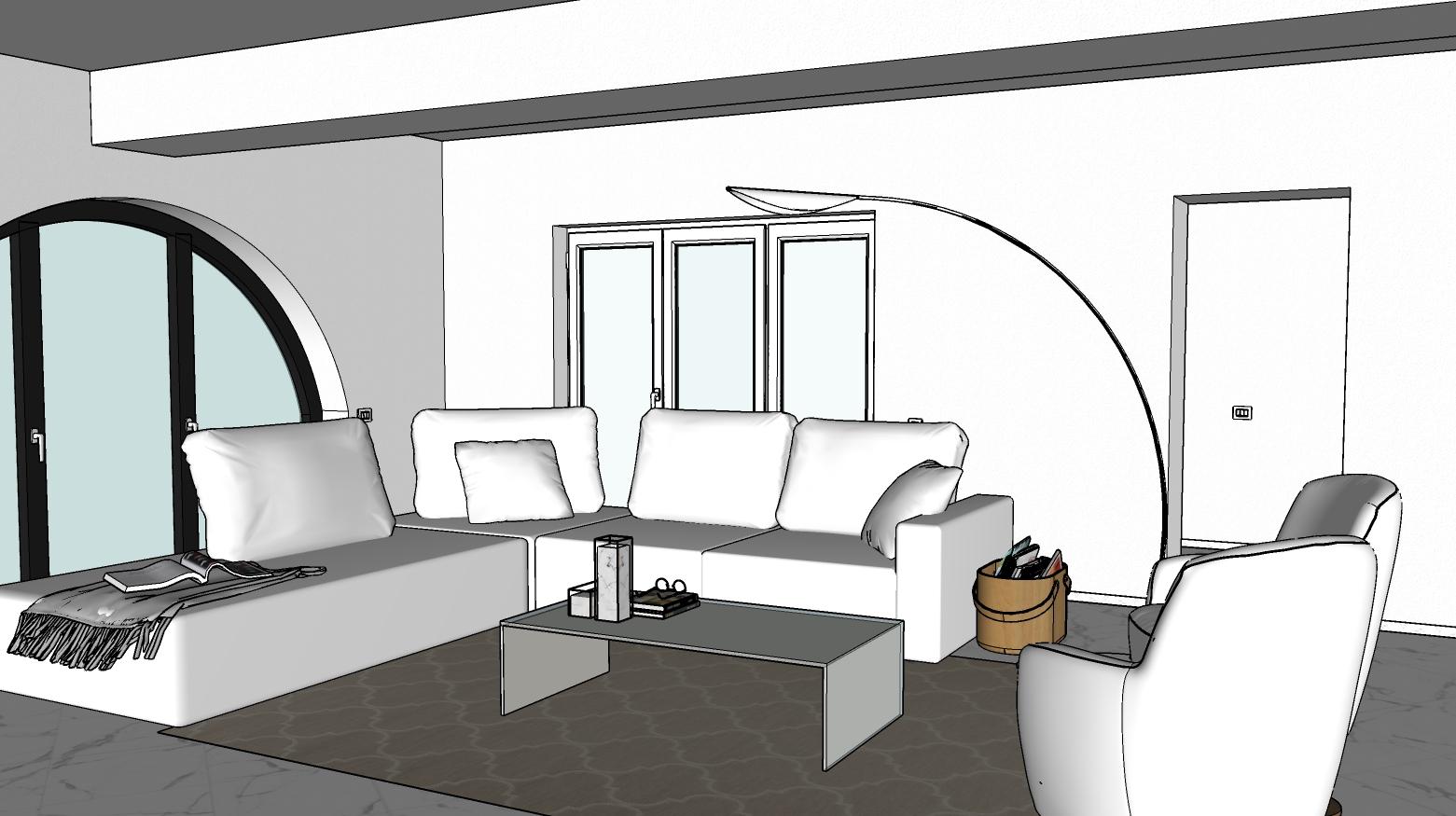 Zona relax con divano, poltroncine, lampada da terra e tavolino