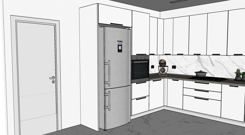 Parte sinistra della cucina. Dettaglio frigo freestanding e colonna forno