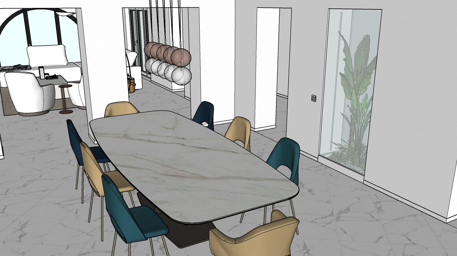 Sala da pranzo con tavolo e sedie di colore diverso