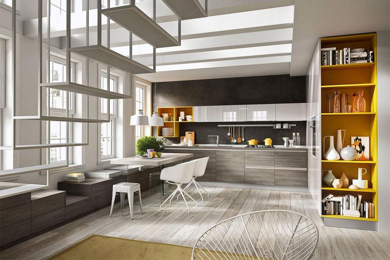 Open space con cucina finita lateralmente con libreria colorata - Five 04