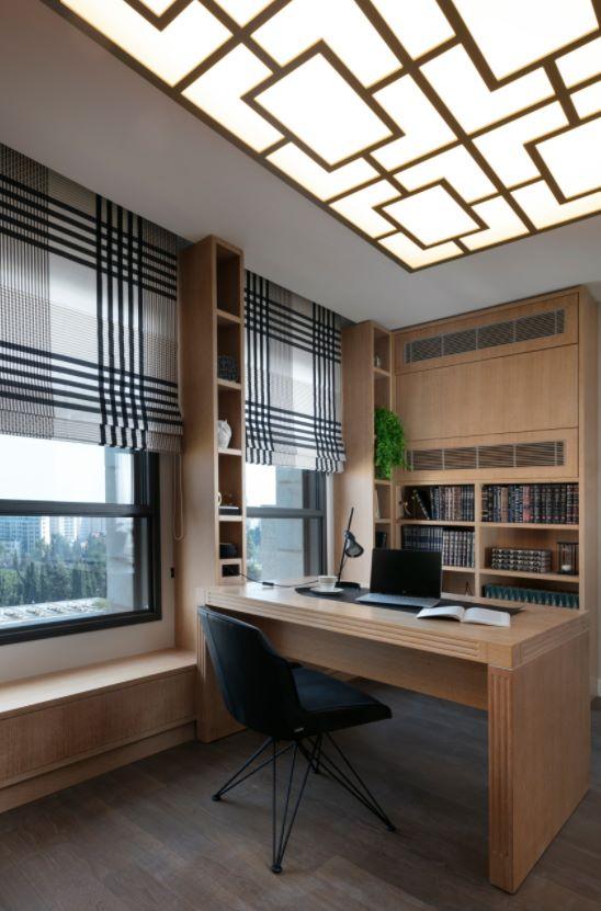 Studio con scrivania e sedia di design